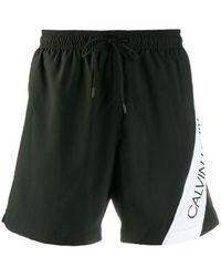 Calvin Klein Short de bain à bande logo contrastante - Noir