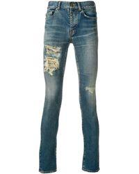Saint Laurent Vaqueros pitillo con detalles rasgados - Azul