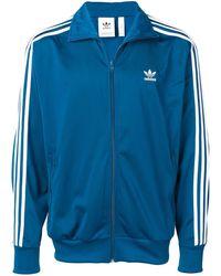 adidas Veste zippée à logo - Bleu