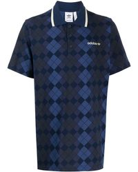 adidas Originals Poloshirt mit Argyle-Muster - Blau