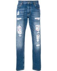 Alexander McQueen Distressed folk embroidery jeans - Bleu