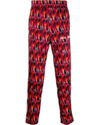 Palm Angels Pantaloni con stampa - Rosso