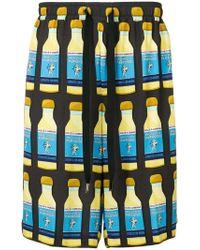 Dolce & Gabbana - Bermudas con estampado de botellas - Lyst