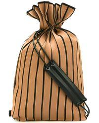 Issey Miyake - Drawstring Leather Trim Backpack - Lyst