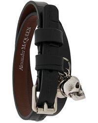 Alexander McQueen Bracelet multi-tour à breloque tête de mort - Noir