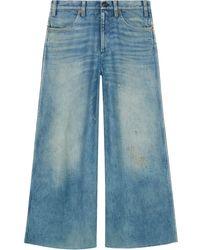 Gucci Hose aus Denim mit Patchs - Blau