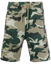 Balmain Short de jogging à motif camouflage - Vert
