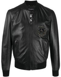 Dolce & Gabbana Veste bomber en cuir à patch logo - Noir