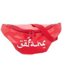 Undercover - Logo Printed Belt Bag - Lyst