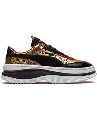 PUMA X Deva Charlotte Sneakers - Zwart