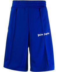 Palm Angels Shorts sportivi con stampa - Blu