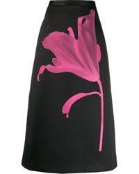 Christopher Kane Jupe midi en satin à imprimé fleur Anthomania - Noir