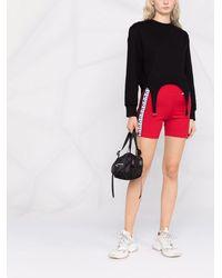 COACH Culottes de ciclismo con logo - Rojo