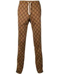 Gucci Pantalon de jogging à motif GG - Marron