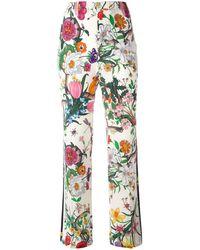 Gucci - Flora Snake Print Pants - Lyst