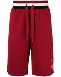 Dolce & Gabbana - Pantalones cortos de deporte con logo - Lyst