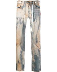 Off-White c/o Virgil Abloh Jeans mit Bleached-Effekt - Blau