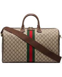 Gucci Reisetasche aus GG Supreme - Braun