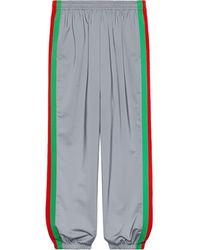 Gucci Pantalone da jogging largo in jersey reflex - Grigio