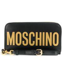 Moschino Portefeuille zippé à logo imprimé - Noir