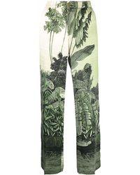 F.R.S For Restless Sleepers Pantalones de seda con hojas estampadas - Verde