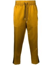 AMI Pantalones de chándal con bandas laterales en contraste - Metálico