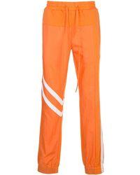 God's Masterful Children Geometric Panelled Track Trousers - Orange