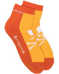 Mastermind Japan Chaussettes bicolores à motif tête de mort - Orange