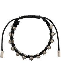 Alexander McQueen Bracelet à breloque tête de mort - Noir