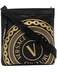Versace Jeans Couture Trousse da bagno con logo goffrato - Nero