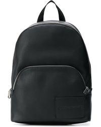 Calvin Klein Sac à dos à logo embossé - Noir