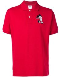 Lacoste - Polo con estampado de Mickey Mouse - Lyst