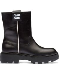 Miu Miu ロゴ アンクルブーツ - ブラック