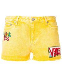 Mira Mikati Patch embroidered shorts - Jaune