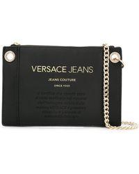 5a1535667a Lyst - Versace Jeans Paneled Foldover Shoulder Bag in Black