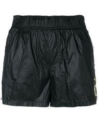 PUMA - Logo Tearaway Mini Shorts - Lyst