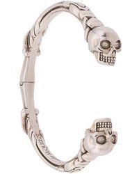 Alexander McQueen Bracelet torque à breloques têtes de mort - Métallisé