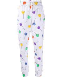 Love Moschino Pantalones de chándal con motivo de piruletas de corazones - Blanco