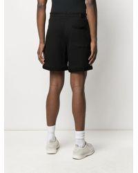 Amiri Shorts sportivi con stampa - Nero
