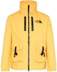 THE NORTH FACE BLACK SERIES Kapuzenjacke mit aufgesetzten Taschen - Gelb