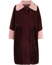 Unreal Fur Manteau oversize bicolore en fourrure artificielle - Rouge