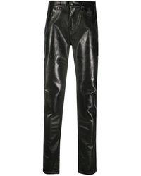 Saint Laurent Beschichtete Skinny-Jeans - Schwarz