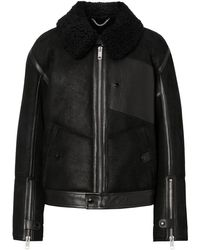 Burberry Veste en shearling et cuir - Noir
