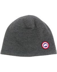 Canada Goose Bonnet à plaque logo - Gris