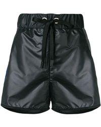 NO KA 'OI - Pantalones cortos deportivos con efecto de charol - Lyst