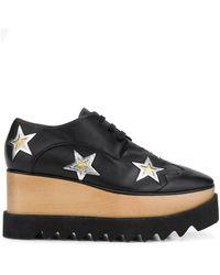 Stella McCartney Stringate Elyse con stelle applicate - Nero