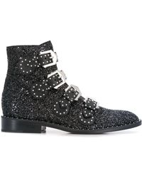 Givenchy Flat Glittered Black Leather Ankle Boots With Silver Buckles And Studs.