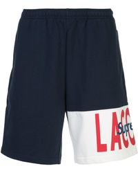 Supreme Pantalones cortos de deporte con logo de x Lacoste - Azul