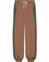 Gucci Joggers con motivo G rombi - Marrone