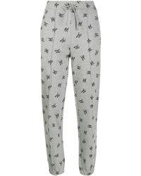 Marc Jacobs Pantalon de jogging à logo imprimé - Gris